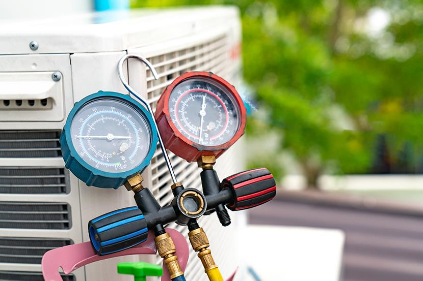 blue and red gauges used to check air conditioner