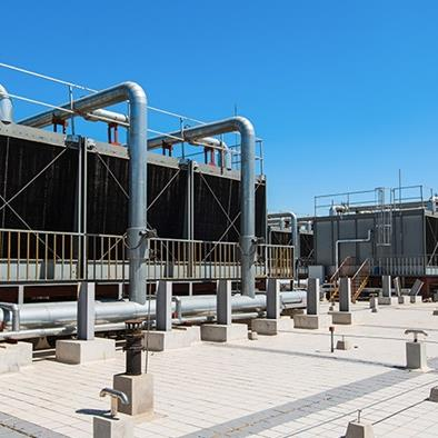 set of cooling towers on commercial building