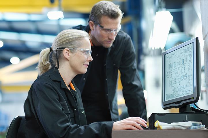 two technicians looking at computer