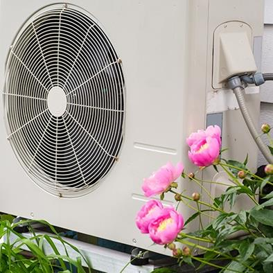 air conditioning heat pump unit on side of a home